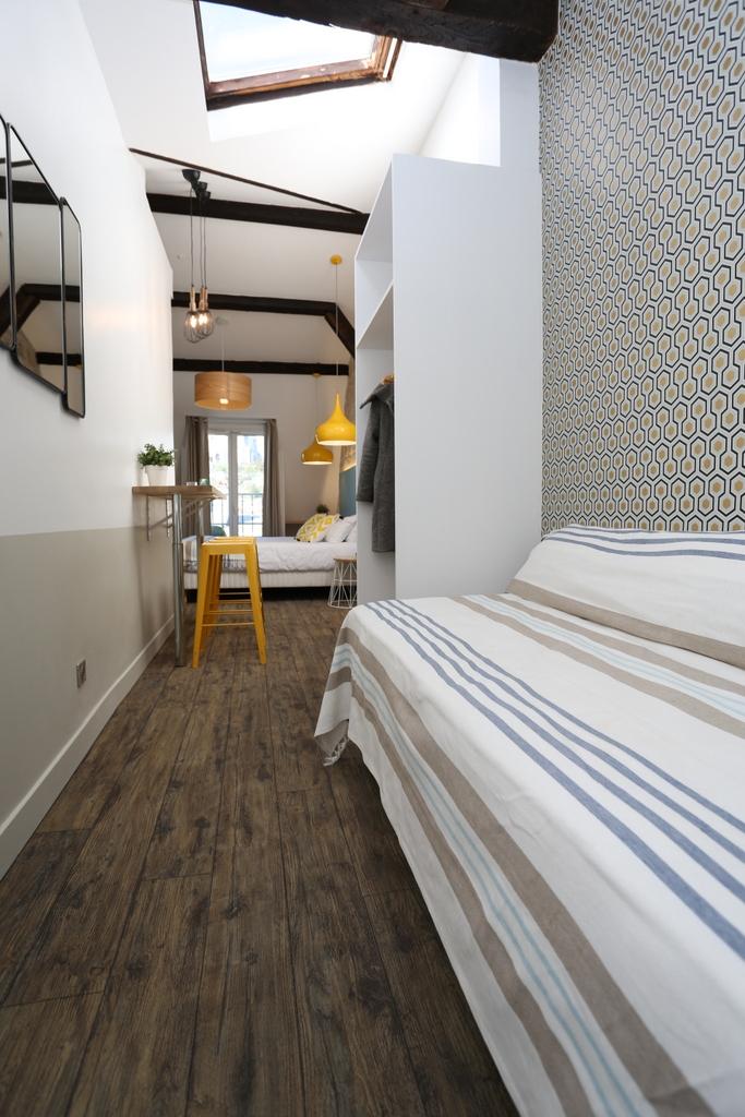 chambre quadruple salle de bain priv e 31 le regent montmartre. Black Bedroom Furniture Sets. Home Design Ideas